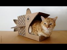 Cats love all sorts of corners and shelters, especially if they're made of cardboard (perfect for some cat nail work). Cardboard Animals, Cardboard Toys, Cardboard Playhouse, Cardboard Furniture, Cat Wall Furniture, Fireplace Furniture, Furniture Design, Cardboard Cat House, Cardboard Fireplace