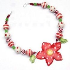 This DIY necklace is full of holiday cheer. Use festive beads and your own creativity to make this Ceramic Poinsettia Necklace suit your style.