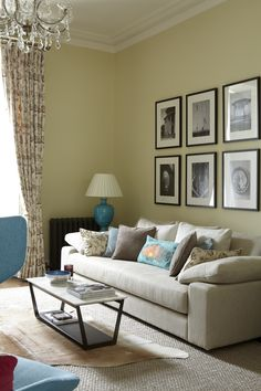 Wall colour Pale Hound by Farrow  Ball; linen sofa from Orior by Design; marble top coffee table by Flexform from Minima; jute rug from Hedgeroe Living; cowskin from Ikea; Hugh Doran photographs from Peter Johnson; blue ceramic lamp from Aidan Cavey; embroidered linen curtains by Mary Wrynne.
