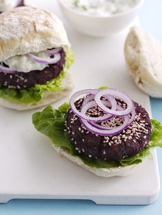 Easy-to-make vegetarian beetroot burgers with herb feta sauce. Under 300 calories - perfect for a midweek meal.