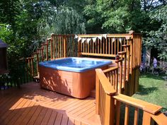 This hot tub sits 10 feet off the ground on a super deck built by one master carpenter.