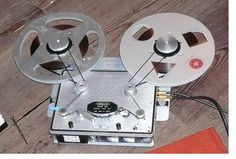 """Stellavox reel-to-reel tape recorder using optional extension arms for 10.5 """" reels. Works surpringly well too. Great machine Swiss watch build quality. =)"""
