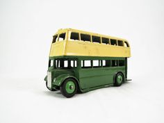 Vintage Dinky Toy, Double Decker Bus Model No. 29C, Type 2 Grille, Very Good Condition, Green Body, Cream Roof, Green Ridged Hubs