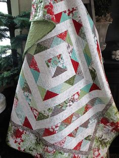 The all-new Blitzen quilt kit is filled with whimsical snowmen in a frosty landscape of snowy whites, enchanting aquas and the merriest of reds and greens! Kits available.