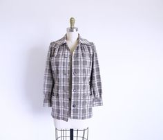 Coat Sale: 60s plaid jacket is lined and has a lapel collar, buttons down the front and at the cuffs and a belt of the same polyester fabric. This fun fitted jacket has three front pockets.    Small size  Measurements with room for comfort  Bust up to 37 inches  Waist up to 30 inches    Exact measurements taken flat  to compare to a garment you own  Length 25inches  Sleeve length 20 inches  Shoulders across the back 15 inches  Bust 19 inches  Waist 15 1/2 inches    Condition is Excellent…