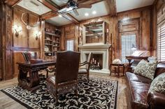 This home office in the Jonas Brothers' Texas home has a rustic look with the wood paneling and brown leather sofa. The fireplace makes this office an inviting and cozy space.
