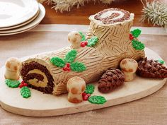 Buche de Noel : Transform your holiday dessert spread into a fantasyland by serving traditional French buche de Noel, or yule log cake. Rich chocolate genoise (sponge cake) is rolled in a coffee- and brandy-flavored buttercream, then decorated with marzipan berries, pinecones and mushrooms. The look of awe on your guests' faces will be well worth the effort.