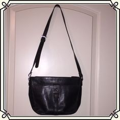 AIGNER BLACK LEATHER CROSSBODY BAG Perfectly pleasing, black leather crossbody or shoulder bag by Etienne Aigner. Adjustable buckle strap, zipper top close. Inside is all black with the Aigner symbol throughout the perfect nylon lining. Multiple zippered compartments, as well as smaller compartments for phone, lipstick, etc. Handbag is in pristine condition, and looks brand new. NWOT condition. No trades/ holds.  Price is firm, unless bundled.  Listing is for bag only; other items can be…