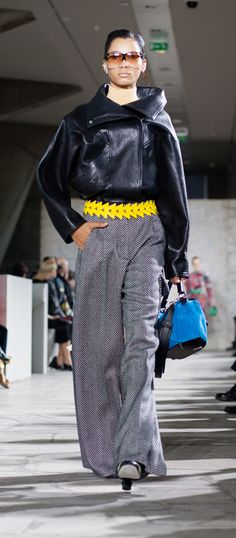 LOEWE Autumn Winter 15 look 3. Oversized bomber jacket-lambskin-black / Herringbone wide leg trousers-wool-silk-blackwhitte / Skin turtle neck sweater-wool-almond / Triangle belt-calf-yellow / Filipa sunglasses-acetate-havana-transparent / Small leaf earring-silver / Small leaf earring-silver-gold / Ibiza earring-silver-rhodium / Puzzle small bag-suede-classic calf-turquoise / Column ring ankle boot-calf-goatskin-navyblue-multicolor