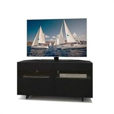 Vision 48'' Corner TV Stand Nexera 102706 $224.80   Vision 48'' Corner TV Stand - Nexera 102706 Vision 48-inches Corner TV Stand allows you to make the best out of your living space. It features 2 doors with glass inserts and 2 adjustable shelves to store your electronic devices, DVDs and other various items away from dust. The corner unit also has solid and removable back panels allowing for easy wire management and air flow. Vision Entertainment Collection is loaded with smart features…