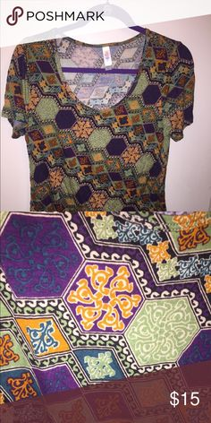 EUC LuLaRoe Classic T Med Mardi Gras Colors Medium Classic T by LuLaRoe, worn once and washed per LLR instructions.  Purple, green and gold wit fleur de lis. LuLaRoe Tops Tees - Short Sleeve