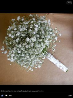 Bridesmaids bouquet of gyp finished with lace and pearl broach made by karen @ finesse floral designs