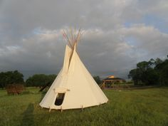The entrance to the tipi is via a half-circle door flap. This can be left open, or rolled up, in hotter weather, while during the colder months a skin is added to provide a welcome second layer. Half Circle, Outdoor Gear, Entrance, Weather, Cold, Entryway, Door Entry, Outdoor Tools, Weather Crafts