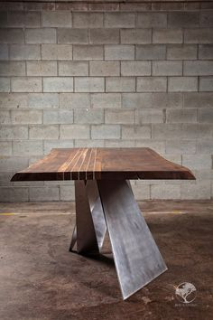 Live edge black walnut dining table with aluminum inserts