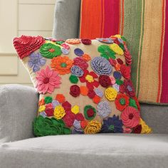 FLOWER FIESTA PILLOW -- Big, beautiful and blooming with brightly colored handmade felt flowers, our natural cotton pillow turns your bed, chair or sofa into a perpetual garden. Feather/down insert