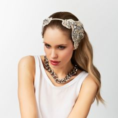 Complete your Spring Racing fashion look with a Mimco racer. A modern take on a classic 1920's aesthetic, our Tough Romance Headband is a beautifully intricate piece to finish your race day look. Featuring delicate beadwork that has been hand embellished onto a champagne coloured canvas base, it is adorned in crystal, faux pearls, and antique metal embroidery. With its symmetrical design, work it back with a centre part for a glamorous flapper styled look.    Shop now