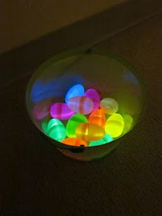 This is a fabulous idea! Get small glow sticks and put them in plastic eggs. Then hid them in the house and turned off the lights for the hunt. Must remember this!