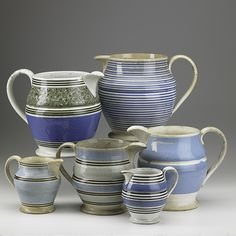 Collection of Mochaware Pitchers in Blue Slip