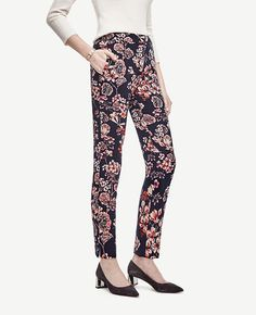 """Strewn in gorgeous geraniums, this slim ankle length pair is slit at the outer cuffs for relaxed-meets-refined appeal. Contoured curtain waistband offers extra tailoring detail for a better fit. Front zip with hook-and-bar closure. Front off-seam pockets. Back welt pockets. Side slits at ankle. 27"""" inseam."""