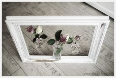 interesting idea.  I like the idea of frames with chicken wire to hold vases