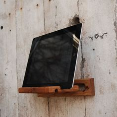 iPad Easel: Reclaimed wood, wall mount and desktop. $50.00, via Etsy.