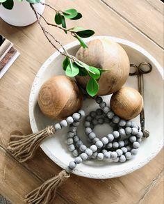 Home decor, ceramic bowl, bead garland, home decor ideas, coffee tablr styling, modern home style