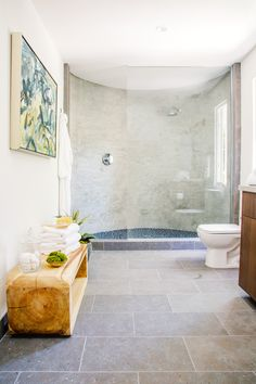 Marble shower with in crisp bathroom