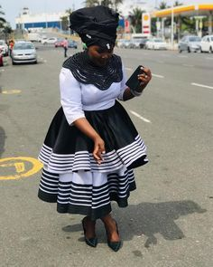 Image may contain: one or more people, people standing, stripes and outdoor African Dresses Plus Size, African Dresses For Kids, African Maxi Dresses, Latest African Fashion Dresses, African Print Fashion, Shweshwe Dresses, African Clothes, Setswana Traditional Dresses, Pedi Traditional Attire