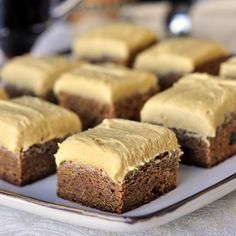 Gingerbread Blondies with Molasses Buttercream Frosting - soft, chewy, blondies with plenty of ginger warmth and a rich, complimentary molasses buttercream frosting. This one is for all you gingerbread lovers out there. You are going to love the wonderful taste and texture of these gorgeous cookies.