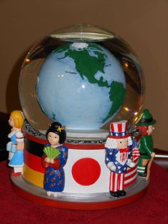 Musical Revolving Christmas Snow Globe with International Nutcracker Characters by RandysGallery, $40.00
