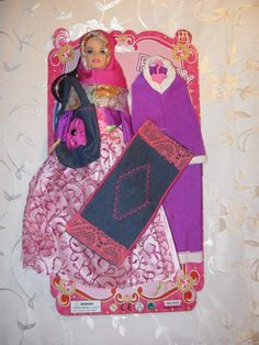 Hijab Barbie -- comes with a prayer mat!