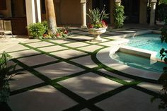 I like the grid of pavers (master courtyard?) with other material in between, and how it meets up with curves of pool border.