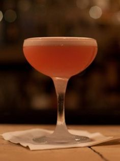 Clover Club:  Gin, Lemon, simple syrup, egg white garnished with raspberries.
