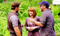 Chris Pratt and Bryce Dallas Howard behind the scenes of 'Jurassic World' with director Colin Trevorrow.