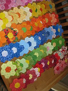 seeing these makes me wanna dig out my grandmothers quilt and finish it.. 250 of these little guys...