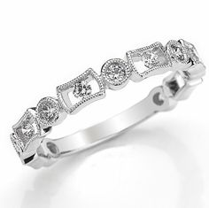 14kt white gold diamond anniversary and stackable ring. There are 13 round brilliant cut diamonds set in the ring with milgrian designs around the diamonds. The diamonds are about 0.40 ct tw, VS1-2 in clarity and G-H in color. #womenweddingbands.com