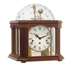 Hermle Tellurium III Specialty Clock 22948-Q10352. h1Hermle Tellurium III Specialty Clock 22948-Q10352_h1The Hermle Tellurium III Specialty Clock 22948-Q10352. The newest within the Tellurium series. This design features an antique walnut finish soloid wood case with fron.. . See More Table Clocks at http://www.ourgreatshop.com/Table-Clocks-C1125.aspx