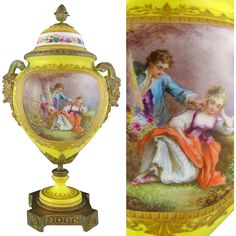 Antique French hand painted porcelain lidded urn vase with gilt bronze mounts, attributed to Sevres. The main body features a lovely dandelion yellow
