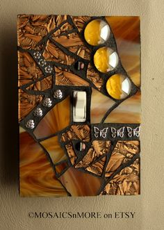 Golden Glamour  -  Handmade Single OVERSIZED Mosaic Light Switch Cover Wall Plate. $17.95, via Etsy.