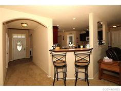 Breakfast nook between entry and living room. Looks into kitchen