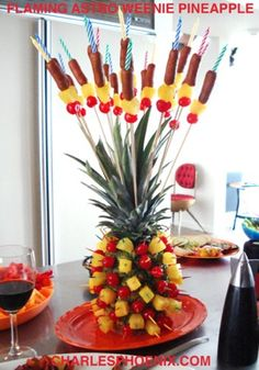 "I found Charles Phoenix's ""Flaming Astro Weenie"" years ago. Since then, I've made at least 10 of these, often without flames and without weenies. For Superbowl 2012, I did the full version + I added some red grapes and sliced oranges on the platter. It was fan-freaking-tastic. Yummy, too!"