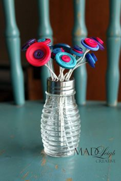 Simple button bouquet in a simple bee hive-esk salt shaker! Easy & cute -- great craft for teachers/kids