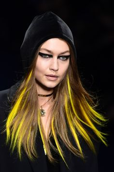 Gigi Hadid Photos Photos - Model Gigi Hadid presents a creation for fashion house Versace during the Women's Fall/Winter 2017/2018 fashion week in Milan, on February 23, 2017.  / AFP / Miguel MEDINA - Versace - Runway - Milan Fashion Week Fall/Winter 2017/18