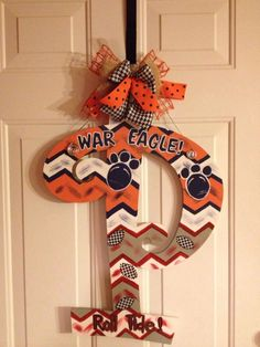 House Divided Initials/Sports items-footballs, etc/door hangers by PaintingonaPrayer on Etsy https://www.etsy.com/listing/203704536/house-divided-initialssports-items