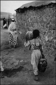 Ara Güler. Returning from the market with watermelons, near the Mardin Gate, Diyarbakir.