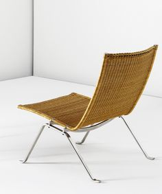 POUL KJÆRHOLM, a pair of low chairs, model PK 22, circa 1956. Cane and matte chrome-plated steel. Manufactured by E. Kold Christensen, Denmark. / Phillips
