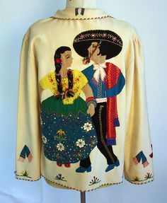 Oh my goodness!  I had one of these when I was a wee girl.  Would like one again.  Mexican tourist jackets.....