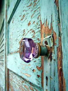 Purple glass knob on chippy blue painted door..awesomeness!