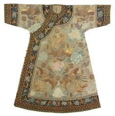 China, Imperial lady's informal gauze robe, Qing Dynasty, Guangxu Period, embroidered with sprigs of large peonies interspersed with couched wanshou medallions, stylized shou characters and flying phoenix in gold-wrapped threads, the black collar and sleeve bands with a similar motif further edged with couched stylized shou characters and florets, the sleeves with an additional black brocade band, framed, 130.7 cm