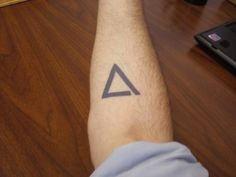 """The broken triangle is an illustration of the Gestalt law of closure. The law of closure demonstrates how the mind creates wholes out of parts – and a world out of sensory information – by 'filling in the gaps.'""  -- Love this as a very simple tattoo idea"